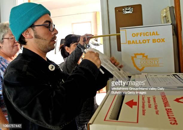 Justin Douglas, of San Bernardino, puts his ballot in the ballot box as residents vote in the midterm elections at the San Bernardino Mountain Search...