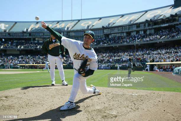 Justin Duchscherer of the Oakland Athletics warms up in the bullpen during the game against the Los Angeles Angels of Anaheim at the McAfee Coliseum...