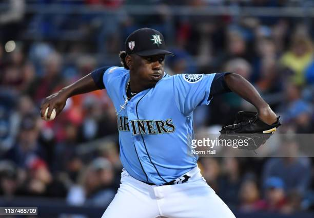 Justin Dunn of the Seattle Mariners delivers a first inning pitch during a spring training game against the Cincinnati Reds at Peoria Stadium on...