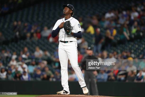 Justin Dunn of the Seattle Mariners reacts after walking his first three batters during his MLB debut in the first inning against the Cincinnati Reds...