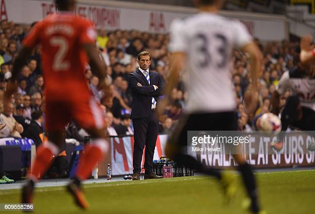 Justin Edinburgh manager of Gillingham looks on during the EFL Cup Third Round match between Tottenham Hotspur and Gillingham at White Hart Lane on...