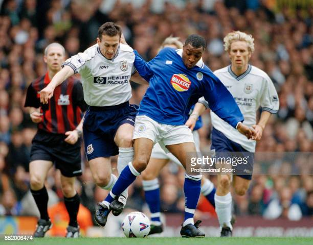 Justin Edinburgh of Tottenham Hotspur and Andy Impey of Leicester City battle for the ball during an FA Carling Premiership match at White Hart Lane...