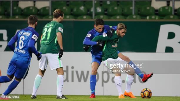 Justin Eiers of Bremen II challenges Soufian Benyamina of Rostock during the 3 Liga match between SV Werder Bremen II and FC Hansa Rostock at...