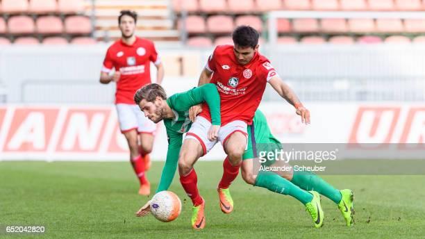 Justin Eilers of Bremen challenges Gerrit Holtmann of Mainz during the Third League match between Mainz 05 II and SV Werder Bremen II at Bruchweg...