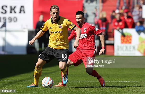 Justin Eilers of Dresden battles for the ball with Valentin Cretu of Cottbus during the third league match between FC Energie Cottbus and SG Dynamo...