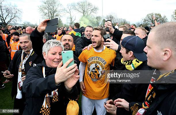 Justin Eilers of Dresden celebrates with supporters after the Third League match between 1 FC Magdeburg and Dynamo Dresden at MDCCArena on April 16...