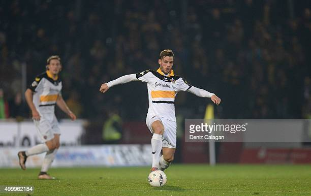 Justin Eilers of Dresden handles the ball during the dritte LIga match between SG Sonnenhof Grossaspach vs Dynamo Dresden on December 4 2015 at...