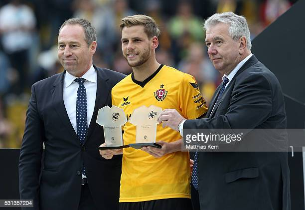 Justin Eilers of Dresden is honored as player of the season 2015/2016 by Peter Frymuth and Ulf Schott of the DFB after the third league match between...