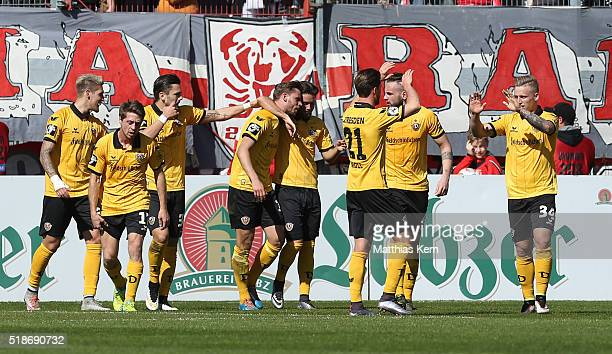 Justin Eilers of Dresden jubilates with team mates after scoring the first goal during the third league match between FC Energie Cottbus and SG...