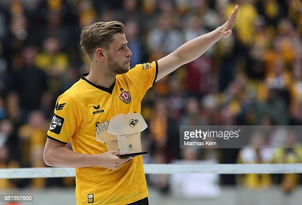 Justin Eilers of Dresden looks on after he was honored as player of the season 2015/2016 after the third league match between SG Dynamo Dresden and...