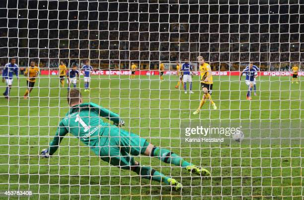 Justin Eilers of Dresden scores the first goal per PenaltyKick Goalkeeper Ralf Faehrmann of Schalke 04 without a chance during the DFB Cup between SG...