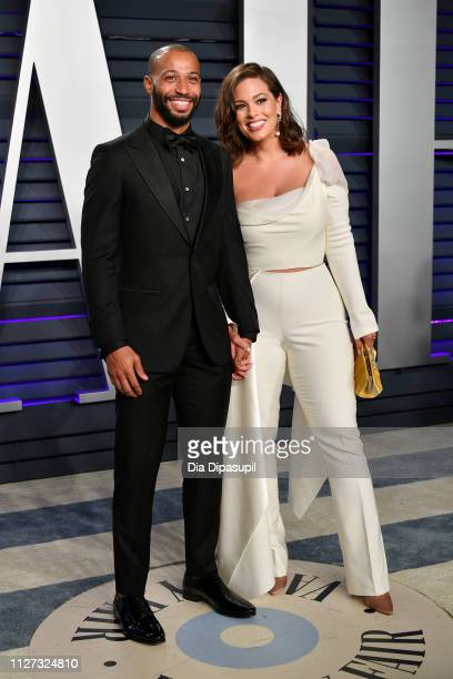 Justin Ervin and Ashley Graham attend the 2019 Vanity Fair Oscar Party hosted by Radhika Jones at Wallis Annenberg Center for the Performing Arts on...