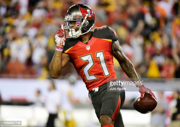 Justin Evans of the Tampa Bay Buccaneers reacts after catching an interception thrown by Ben Roethlisberger of the Pittsburgh Steelers on September...