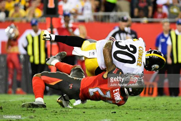 Justin Evans of the Tampa Bay Buccaneers wraps up James Conner of the Pittsburgh Steelers in the first quarter against the Pittsburgh Steelers on...