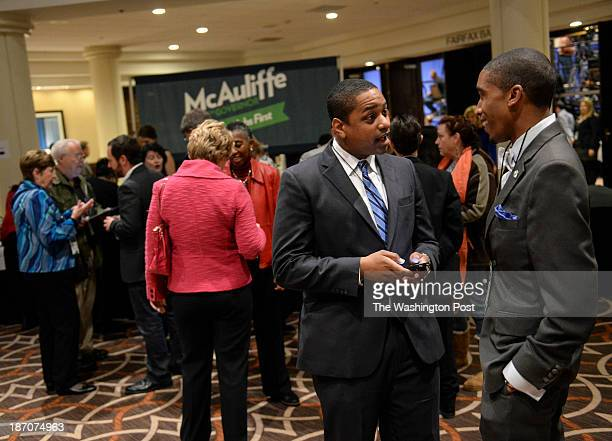 Justin Fairfax left and Brandon Randleman right an intern for Senator Henry Marsh talk before an election night event in support of Terry McAuliffe...