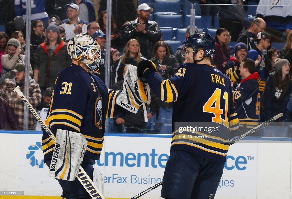 Justin Falk #41 of the Buffalo Sabres congratulates Chad Johnson #31 following their 5-3 victory against the Tampa Bay Lightning in an NHL game on February 13, 2018 at KeyBank Center in Buffalo, New York.