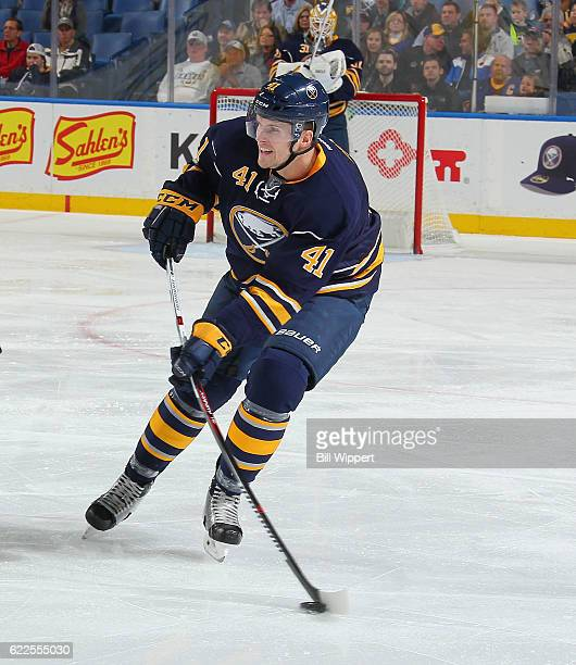 Justin Falk of the Buffalo Sabres looks to pass against the New Jersey Devils during an NHL game at the KeyBank Center on November 11 2016 in Buffalo...