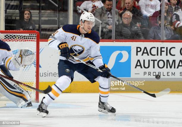 Justin Falk of the Buffalo Sabres plays the puck against the Arizona Coyotes at Gila River Arena on November 2 2017 in Glendale Arizona
