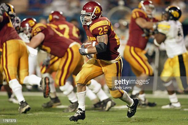 Justin Fargas of USC carries the ball against Iowa during the FedEx Orange Bowl at Pro Player Stadium on January 2, 2003 in Miami, Florida. The...