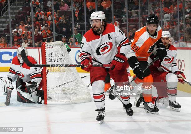 Justin Faulk Nino Niederreiter and Curtis McElhinney of the Carolina Hurricanes react to the play along the far boards against Corban Knight of the...