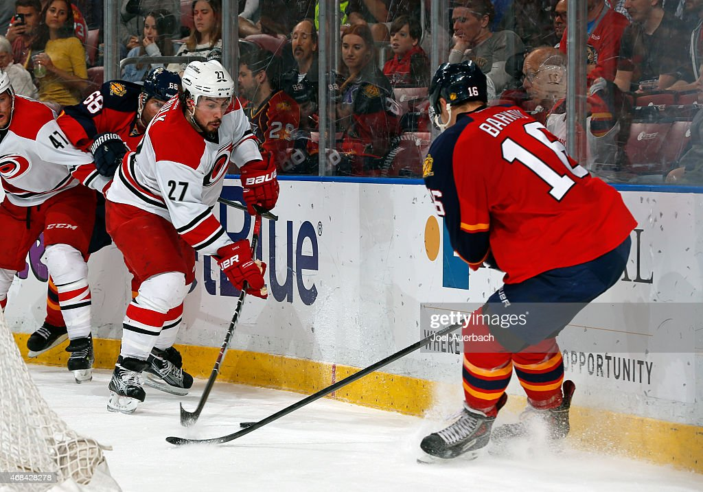 Justin Faulk #27 of the Carolina Hurricanes battles for the puck with Aleksander Barkov #16 of the Florida Panthers during second period action at the BB&T Center on April 2, 2015 in Sunrise, Florida. The Panthers defeated the Hurricanes 6-1.