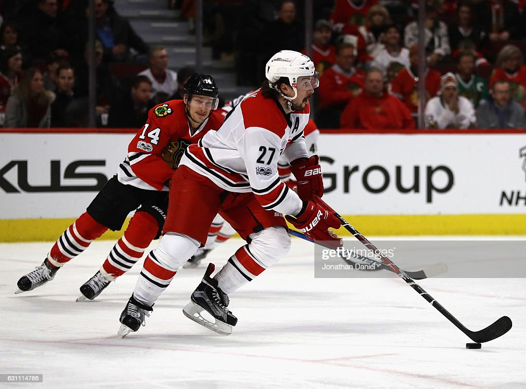Justin Faulk #27 of the Carolina Hurricanes breaks away from Richard Panik #14 of the Chicago Blackhawks at the United Center on January 6, 2017 in Chicago, Illinois. The Blackhawks defeated the Hurricanes 2-1.