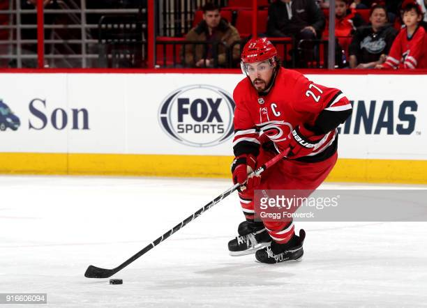 Justin Faulk of the Carolina Hurricanes carries the puck during an NHL game against the San Jose Sharks on February 4 2018 at PNC Arena in Raleigh...