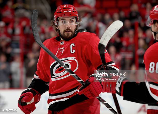 Justin Faulk of the Carolina Hurricanes celebrates after scoring a goal during an NHL game against the Los Angeles Kings on February 13 2018 at PNC...