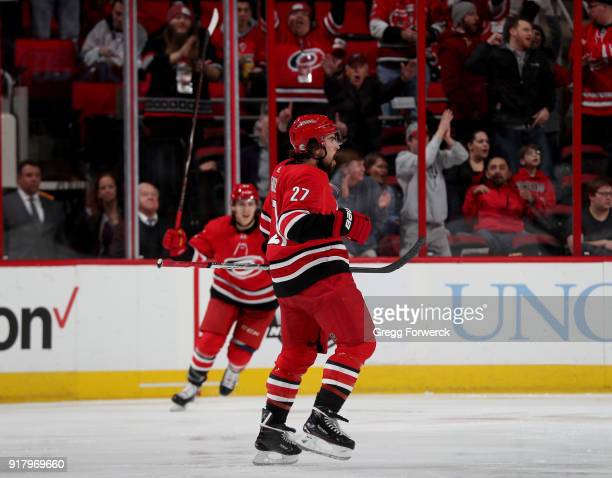 Justin Faulk of the Carolina Hurricanes celebrates after scoring a hat trick during an NHL game against the Los Angeles Kings on February 13 2018 at...