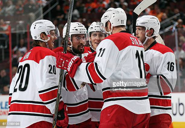 Justin Faulk of the Carolina Hurricanes celebrates his second period powerplay goal against the Philadelphia Flyers with teammates Sebastian Aho...