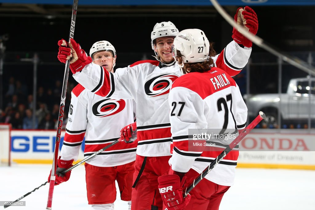 Justin Faulk #27 of the Carolina Hurricanes celebrates his second period goal with Noah Hanifin #5 during the game against the New York Islanders at the Barclays Center on March 13, 2017 in Brooklyn borough of New York City.