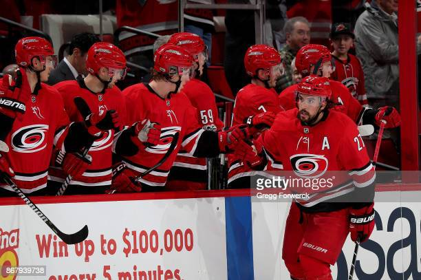 Justin Faulk of the Carolina Hurricanes celebrates with teammates after scoring during an NHL game against the Anaheim Ducks on October 29 2017 at...