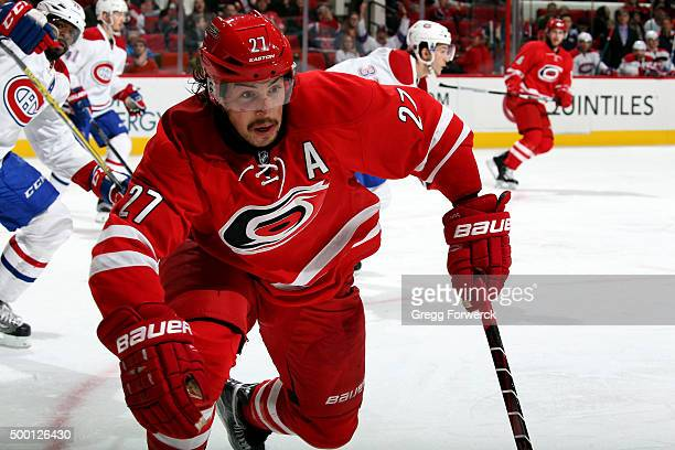 Justin Faulk of the Carolina Hurricanes chases down a loose puck during an NHL game against the Montreal Canadiens at PNC Arena on December 5 2015 in...
