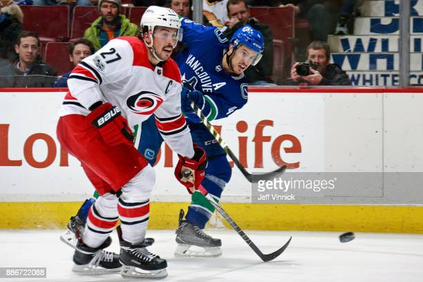 Justin Faulk of the Carolina Hurricanes checks Michael Del Zotto of the Vancouver Canucks during their NHL game at Rogers Arena December 5 2017 in...
