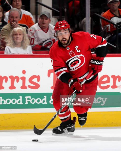 Justin Faulk of the Carolina Hurricanes controls the puck on the ice during an NHL game against the Philadelphia Flyers on February 6 2018 at PNC...