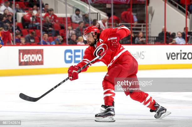 Justin Faulk of the Carolina Hurricanes fires a slap shot on goal during an NHL game against the New York Islanders on April 6 2017 at PNC Arena in...