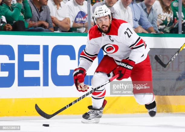 Justin Faulk of the Carolina Hurricanes handles the puck against the Dallas Stars at the American Airlines Center on October 21 2017 in Dallas Texas
