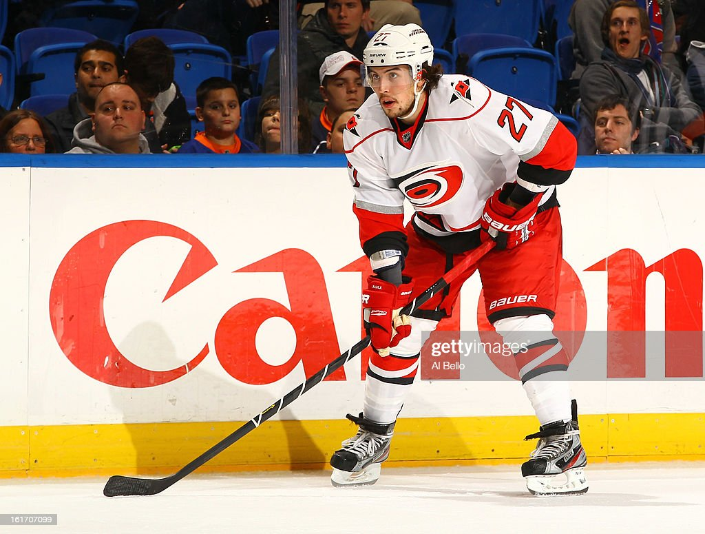Justin Faulk #27 of the Carolina Hurricanes in action against the New York Islanders during their game at Nassau Veterans Memorial Coliseum on February 11, 2013 in Uniondale, New York.