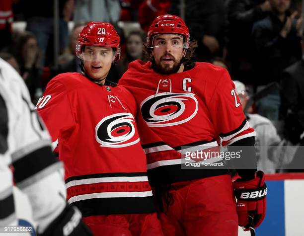 Justin Faulk of the Carolina Hurricanes is congratulated by teammate Sebastian Aho after scoring a goal during an NHL game against the Los Angeles...