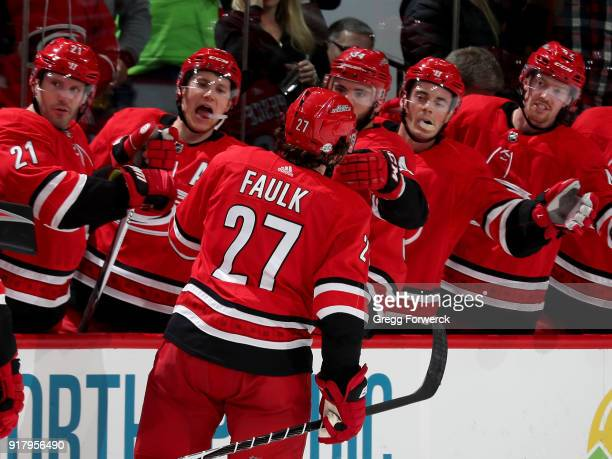 Justin Faulk of the Carolina Hurricanes is congratulated by teammates after scoring a goal during an NHL game against the Los Angeles Kings on...