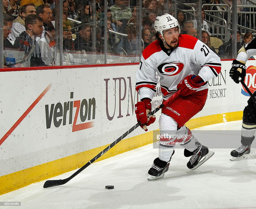 Justin Faulk #27 of the Carolina Hurricanes moves the puck against the Pittsburgh Penguins on April 1, 2014 at Consol Energy Center in Pittsburgh, Pennsylvania.