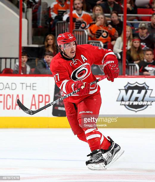 Justin Faulk of the Carolina Hurricanes passes the puck during a NHL game against the Philadelphia Flyers at PNC Arena on November 14 2015 in Raleigh...