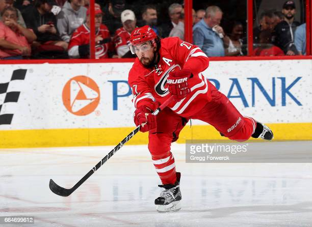 Justin Faulk of the Carolina Hurricanes passes the puck during an NHL game against the Detroit Red Wings on March 28 2017 at PNC Arena in Raleigh...