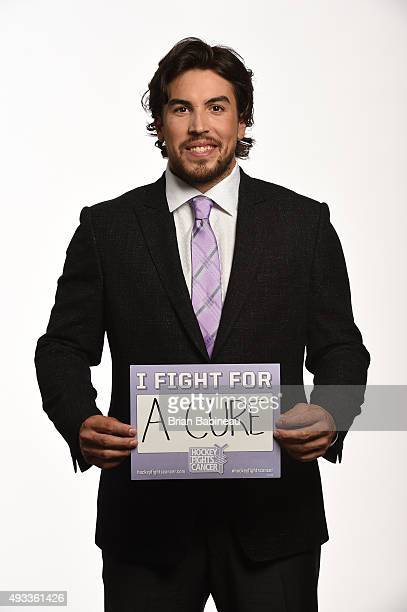 Justin Faulk of the Carolina Hurricanes poses for a portrait at the NHL Player Media Tour at the Ritz Carlton on September 8 2015 in Toronto Ontario