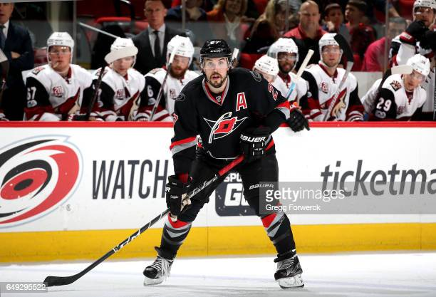 Justin Faulk of the Carolina Hurricanes prepares for a faceoff during an NHL game against the Arizona Coyotes on March 3 2017 at PNC Arena in Raleigh...