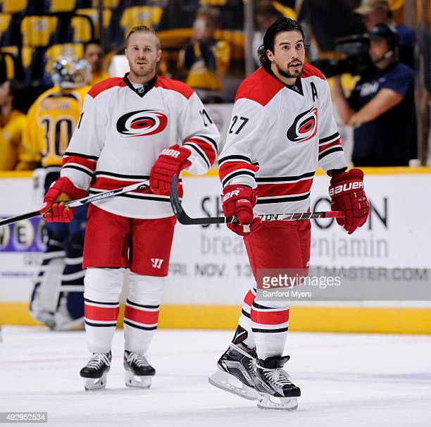 Justin Faulk of the Carolina Hurricanes right and James Wisniewski of the Carolina Hurricanes warmup before their game against the Nashville...