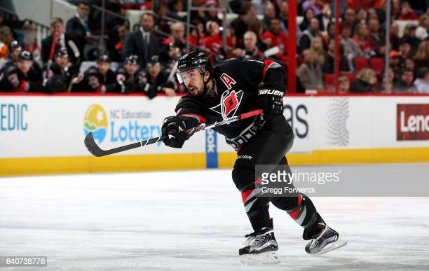 Justin Faulk of the Carolina Hurricanes shoots the puck during an NHL game against the Philadelphia Flyers on January 31 2017 at PNC Arena in Raleigh...