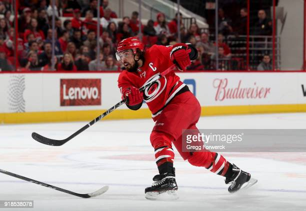 Justin Faulk of the Carolina Hurricanes shoots the puck during an NHL game against the Vancouver Canucks on February 9 2018 at PNC Arena in Raleigh...