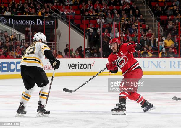 Justin Faulk of the Carolina Hurricanes shoots the puck during an NHL game against the Boston Bruins on March 13 2018 at PNC Arena in Raleigh North...