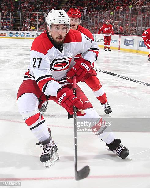 Justin Faulk of the Carolina Hurricanes skates after a loose puck during an NHL game against the Detroit Red Wings on April 11 2014 at Joe Louis...